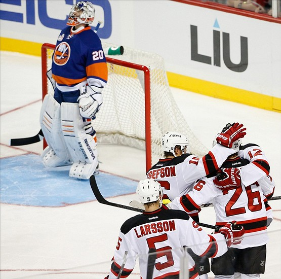 d8024f1e1fe Sep 21, 2013; Brooklyn, NY, USA; New Jersey Devils left wing Patrik Elias  (26) celebrates scoring a goal with teammates during the second period  against the ...